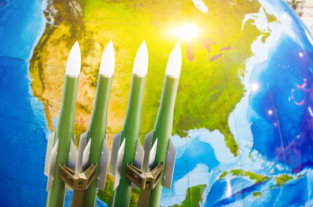 Race of weapons, nuclear weapons, the threat of war in the world. Rockets in the background of North America Stock Photo