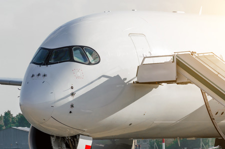 Nose of the passenger and the cockpit of the pilot, airplane close up