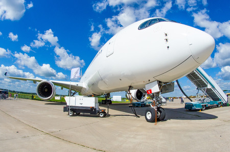 Airplane is parked at the airport with a gangway waiting for boarding of passengers Stock fotó