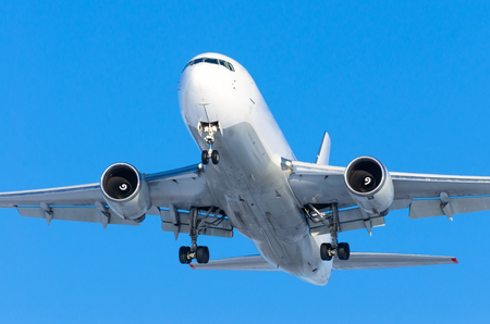Heavyjet airplane flying above the blue sky