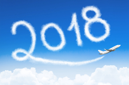 Happy New year 2018 concept. Drawing by airplane vapor contrail in sky Banco de Imagens