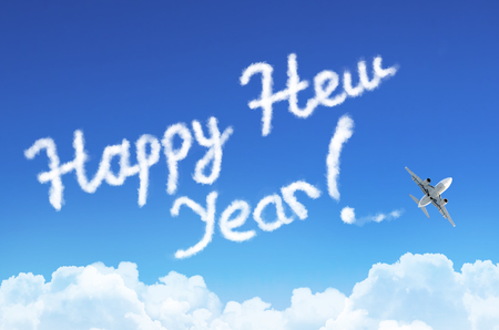 The inscription Happy New Year in the sky from the cloud and steam, flying airplane