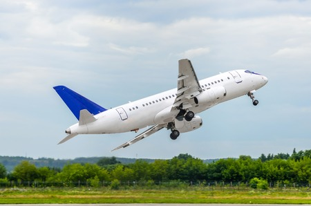 Sharp rapid take off of a passenger aircraft at the airport Stock Photo