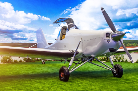 Turboprop aircraft with open cockpit pilot in the meadow