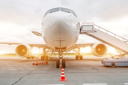 Passenger aircraft parked at the airport with ladder ladder
