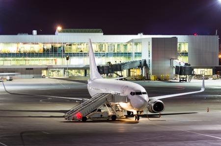 Passenger aircraft parked at night at the airport