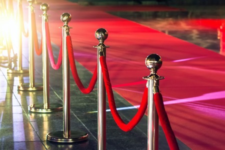 Portable Barrier for Queue Control. Red security rope by red carpet Фото со стока - 91315713