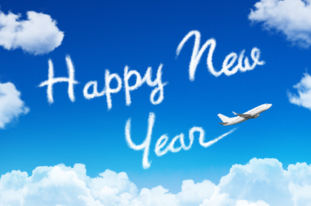 Happy New year concept. Drawing by airplane vapor contrail in sky