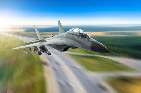 Aircraft fighter flies at high speed over the highway and city Stockfoto