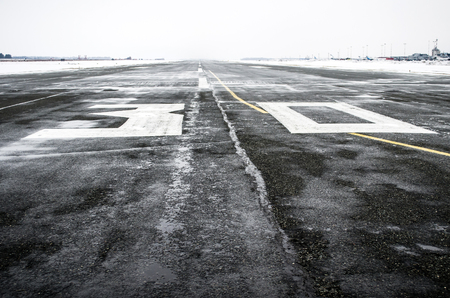 Wet to the airport in cloudy weather in winter