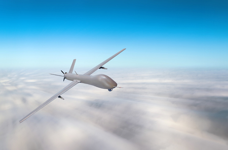 Unmanned military aircraft fly high speed background blue sky clouds Stock Photo