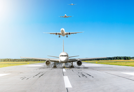 Airplane moves down the runway after landing in the background in the sky turn from passenger aircraft calling at landing at the airport