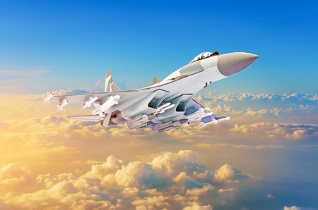 Military fighter aircraft at high speed, flying high in the sky sunset Stock Photo