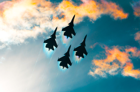 Group of airplane fighter jet airplane sun glow toned sky Stock Photo