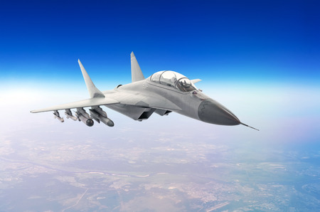 Military fighter aircraft at high speed, flying high in the sky