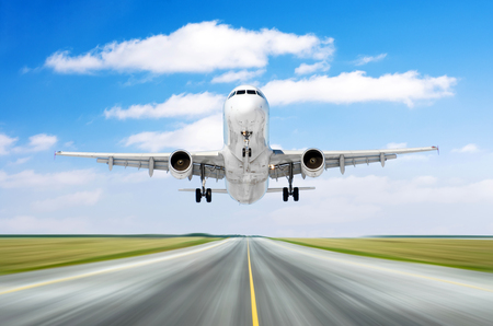 Airplane aircraft flying departure landing speed motion on a runway in the good weather with cumulus clouds sky day