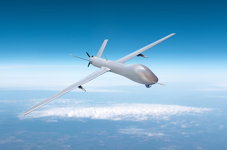 Unmanned military drone on patrol air territory at high altitude