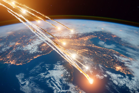 Falling burning flares of several meteorites of asteroids in the Earth's atmosphere. Stock Photo