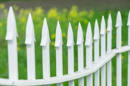 Metal fencing with sharp tips on the park background