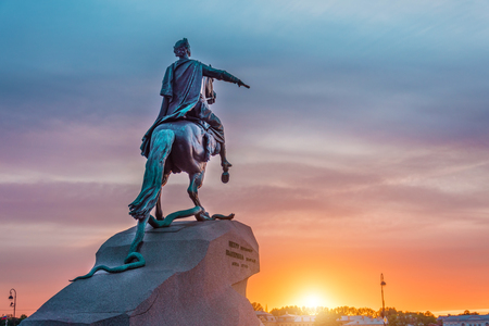 Statue of the monument to Peter 1, Bronze Horseman in Saint-Petersburg at sunset evening sky