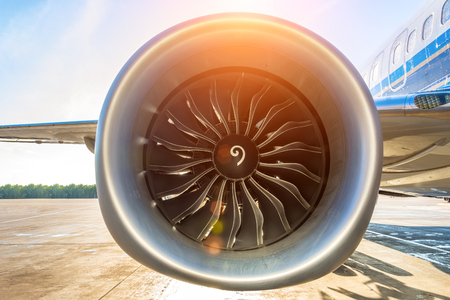 Close up of turbojet of aircraft turbine engine fan civil with a gradient of colors from cold to warm sun glare lights Stock Photo