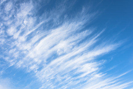 High cirrus clouds with blue sky background