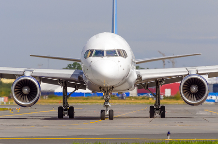 Airplane taxiing on the apron of the airport on the asphalt is visible marking Stock Photo