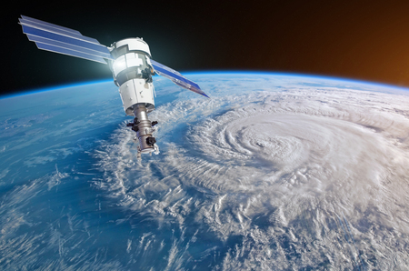 Research, probing, monitoring Florence raging on the coast. Satellite above the Earth makes measurements of the weather parameters.