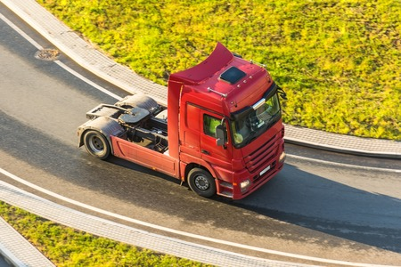 Modern truck without at the turn of the highway