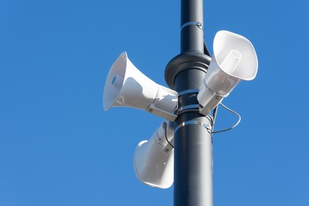 Loudspeaker on a pole in the city, the public alert system