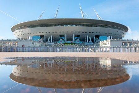 Aerial view of the stadium Zenit Arena, with reflection in a puddle of water on asphalt. Russia, Saint-Petersburg, 11 October 2018