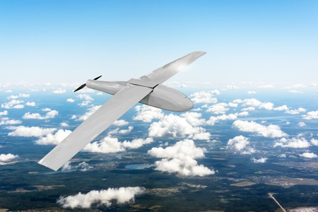Patrolling unmanned aircraft in the sky above the terrain, fly tracking