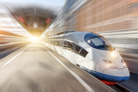 High speed train rides at the railway station in the city