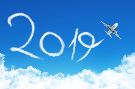 Happy New year 2019 concept. Drawing by plane vapor contrail in sky