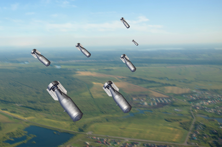 Falling bombs weapons charges dropped from a fighter combat aircraft Stock Photo