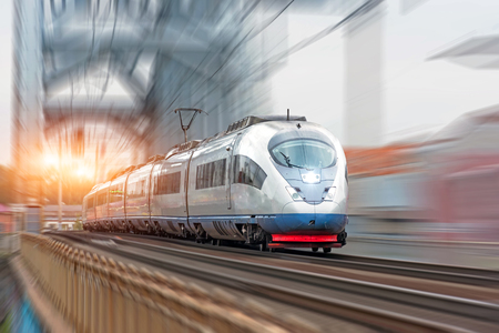 Passenger train follows the route at high speed.