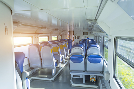Salon inside of the speed commuter train with empty seats