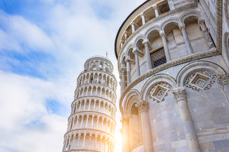 Leaning Tower of Pisa with a sun flare at sunset