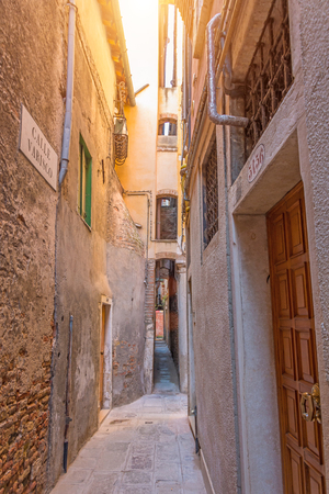 The narrowest street sight in the city of Venice is Calle varisco Archivio Fotografico