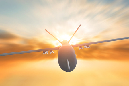 Military drone flight motion blur on sunset background. Close up view