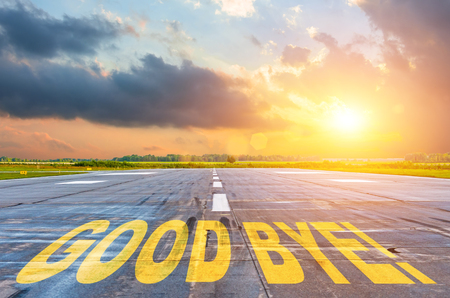 Good luck written on runway road airport at sunset. Stock Photo - 118763293