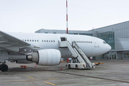 Ladder by the passenger aircraft, waiting for the passengers to board at the aeroopt terminal. Stock Photo