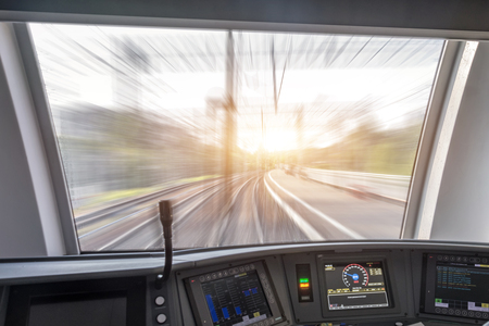 View from the cabin of the passenger train to the railway and turn at the speed of movement.