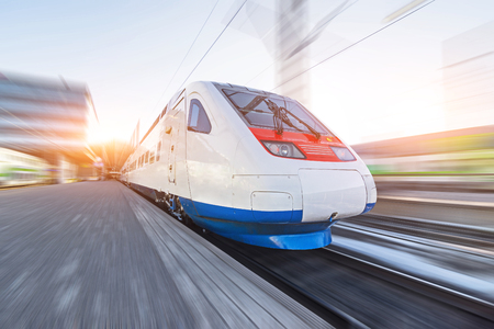 Train traveling at high speed in the city.