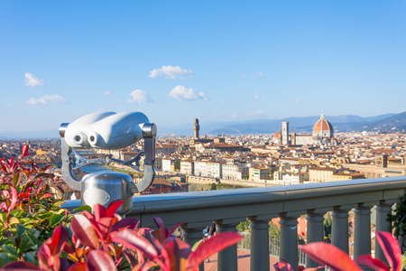 View of the city from the observation deck Piazzale Michelangelo in Florence, in the foreground binoculars.