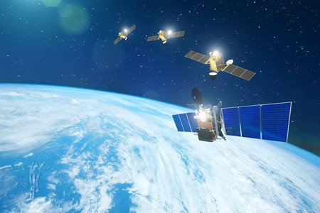 Group of satellites in a row orbiting the earth, for communication and monitoring systems. Фото со стока