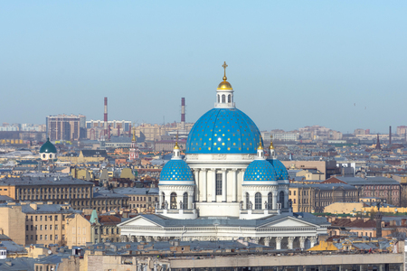 Trinity Cathedral with a blue dome and gold stars on the background of roofs in the city of St. Petersburg 版權商用圖片