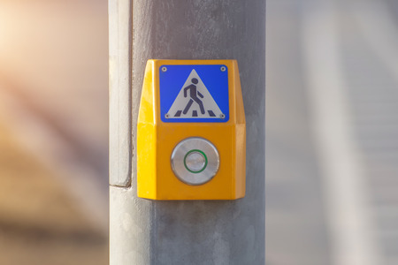 Touch button to turn on the green light at a pedestrian crossing on the highway Stock Photo