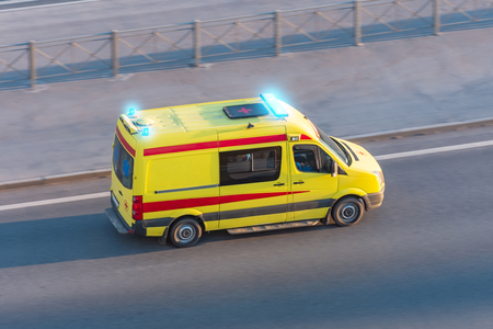 Ambulance van fast ride on highway, aerial top view