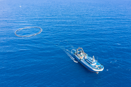 Fishing boat with special equipment for fishing, fish frame sails in the Mediterranean sea